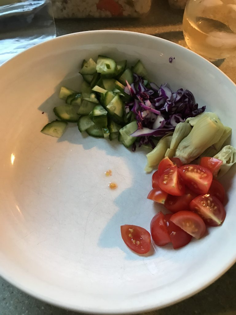 Cucumbers, red cabbage, artichoke hearts, cherry tomatoes